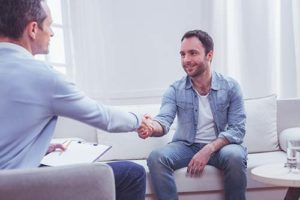 patient shaking therapist hand at virginia psychiatric counseling center programs