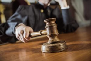 judge with gavel ruling on court involved treatment